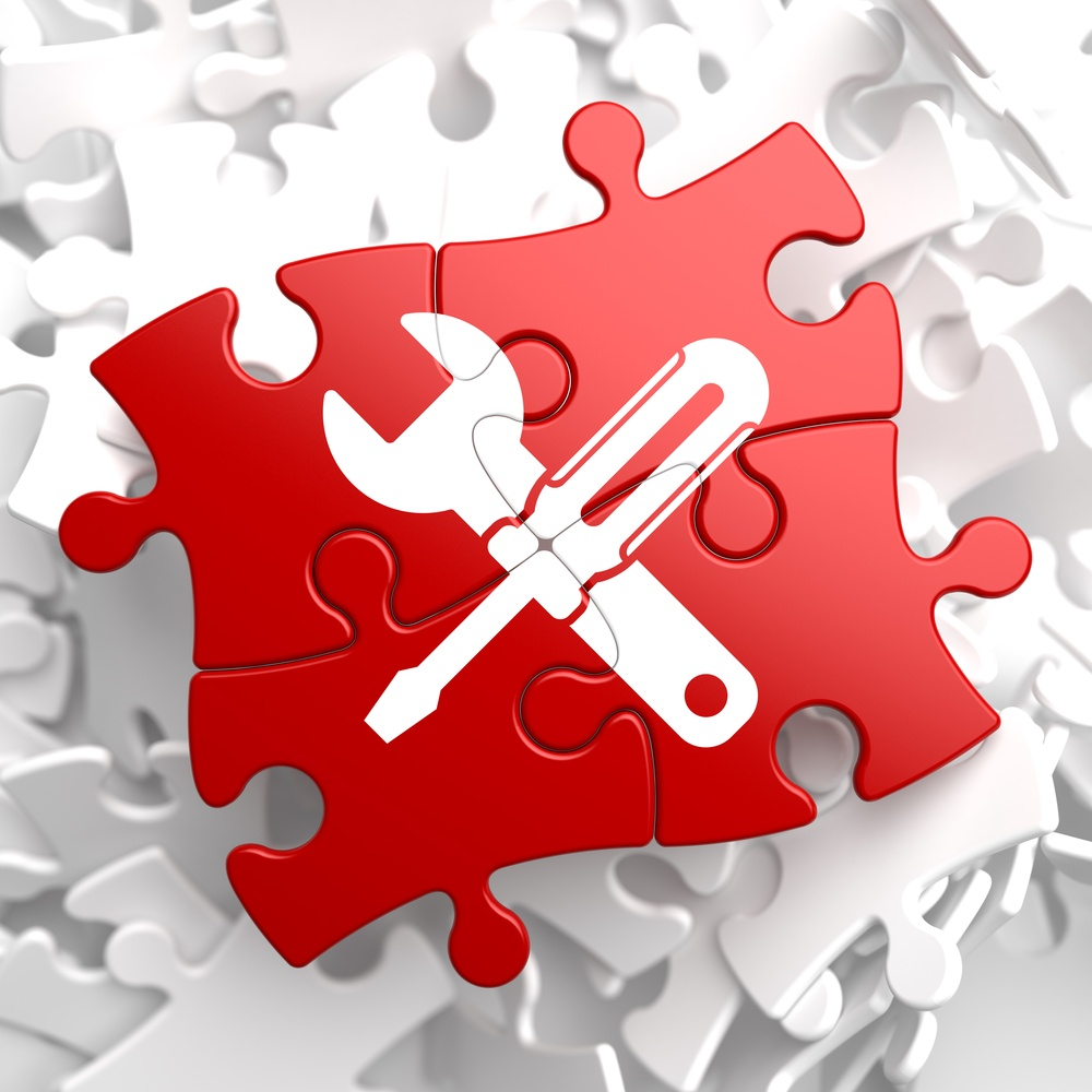 Free tool Concept - Icon of Crossed Screwdriver and Wrench on Puzzle Piece.