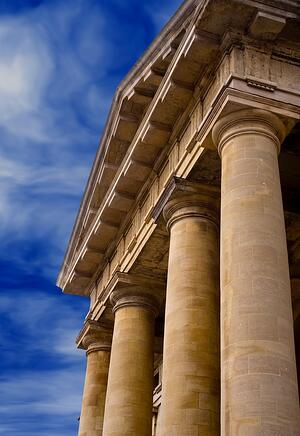 Columns of justice over blue sky