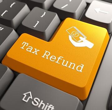 Tax Refund - Orange Button on Computer Keyboard.