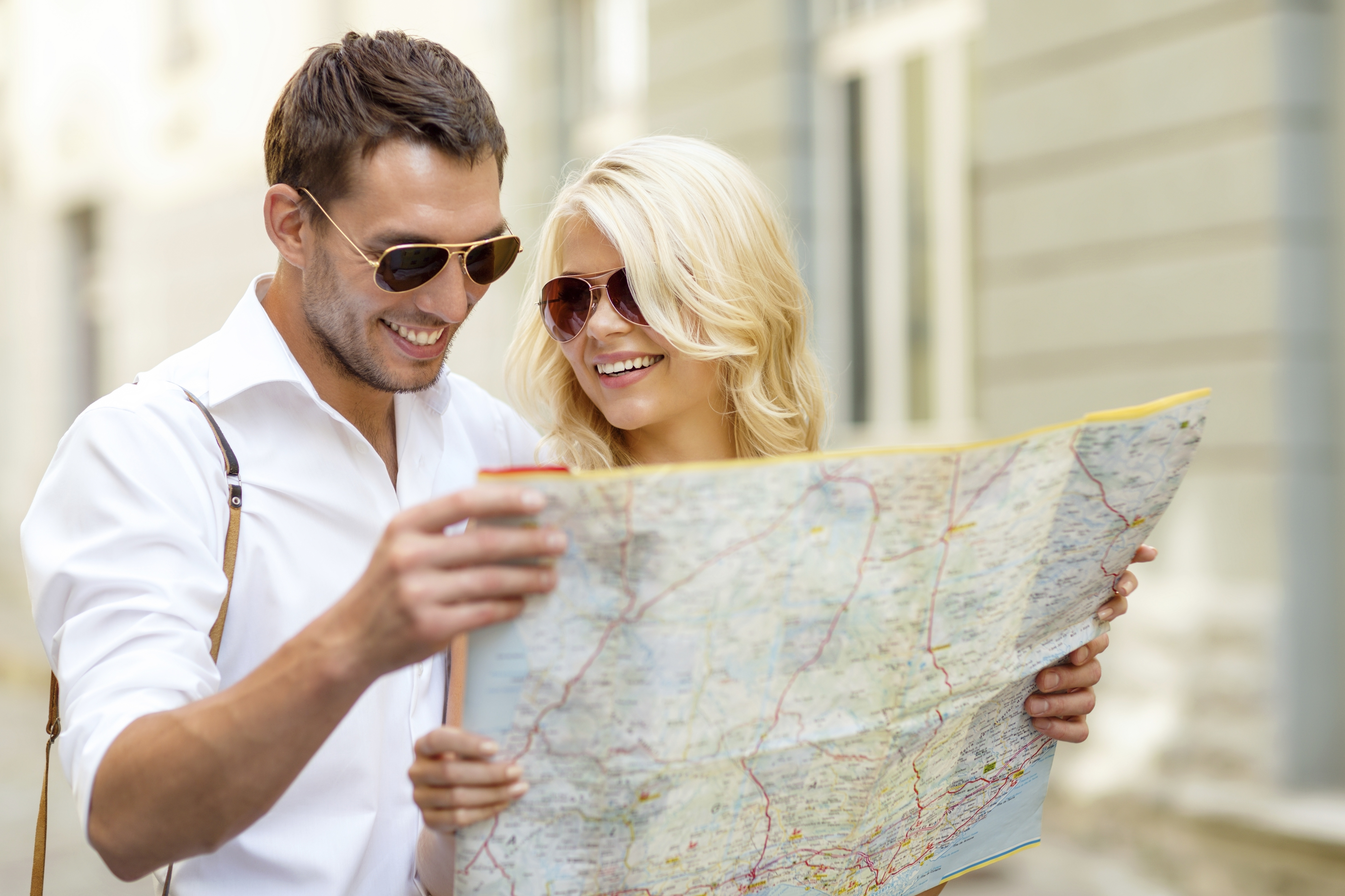 couple exploring with map