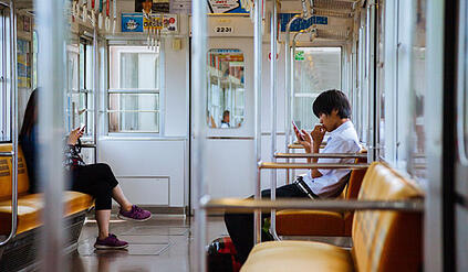 people-riding-train-in-nara-japan