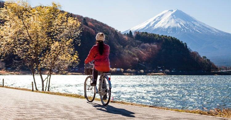 woman-riding-bike-near-mount-fuji-japan
