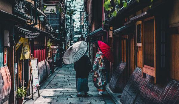 women-walking-down-street-in-kyoto-japan