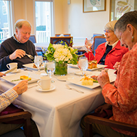 Older couple enjoying lunch at a retirement community cafe