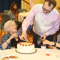 Woman resident celebrating her birthday with fellow residents