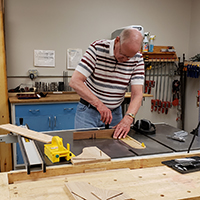 Older man working within the woodworking shop
