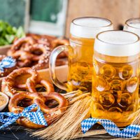 A table with pretzels beer and hummus to celebrate oktoberfest