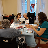 A group of residents tap into beloved memories while painting