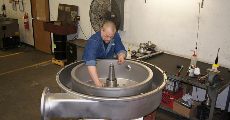 Image of a man reassembling a centrifuge machine