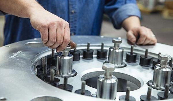 hands doing centrifuge repair