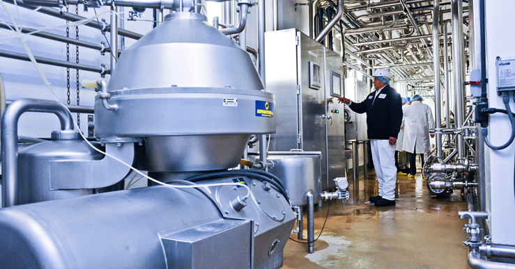 Image of a man pressing a button on equipment at a plant-1