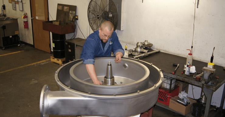 Image of man fixing a centrifuge