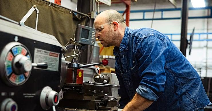 centrifuge operator working on machinery