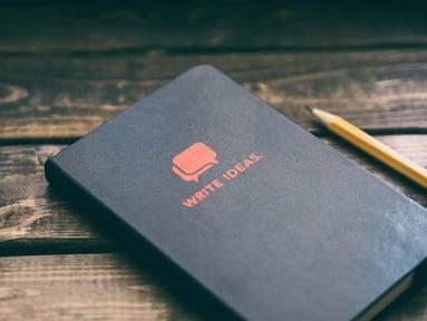 ideas_notebook_aaron-burden-AXqMy8MSSdk-unsplash