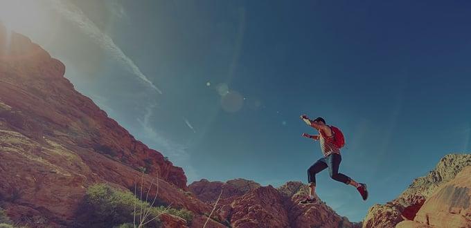 man-person-jumping-desert-1440x700