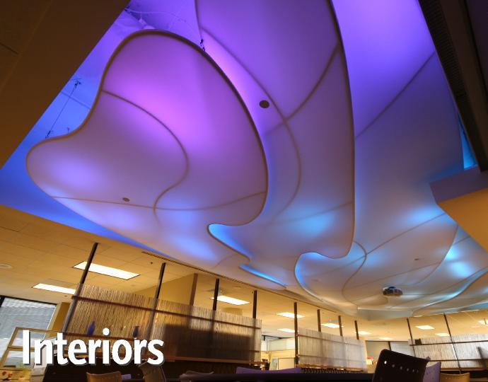 Color-changing backlit tension fabric Clouds are suspended over the employee lounge in Mulvanny G2 Architecure's Irvine, CA office.