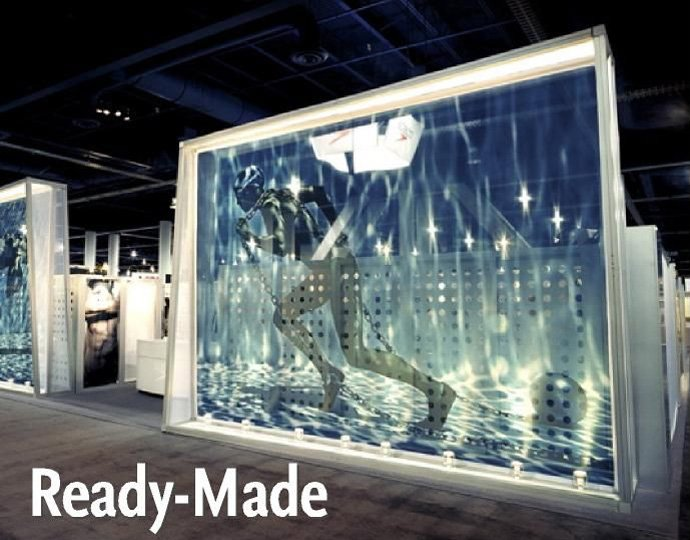 Large-format image shows Michael Phleps dragging a ball and chain across the bottom of the pool in this exhibit for Speedo. Design by Avalon Exhibits, using a Transformit Pablo wall from the Dynamics collection.