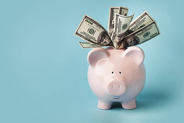 pink-piggybank-stuffed-with-dollar-bills-marsbars