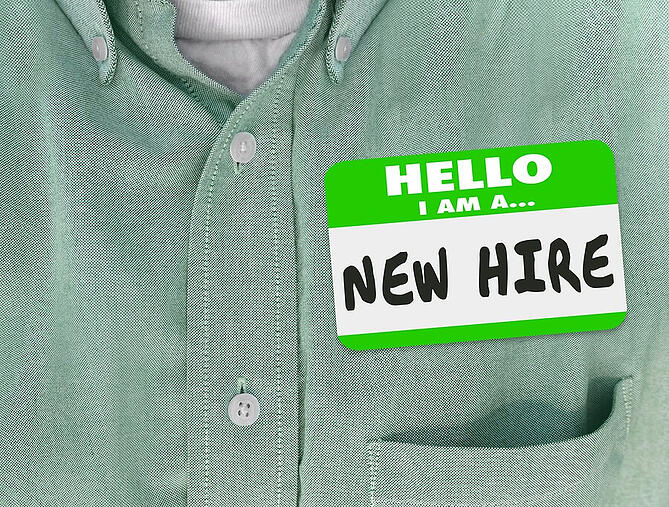 bigstock-New-Hire-nametag-on-a-green-sh-110199299-1