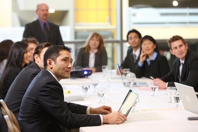 bigstock-Business-people-in-board-room-14088314-1
