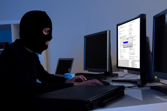 canstockphoto12385307-hackerdownloading-1024x683