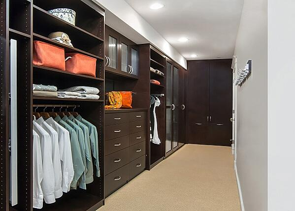 Deluxe Walk-in Closet by Valet Custom Cabinets & Closets
