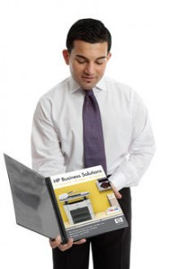 Salesman presenting custom catalog