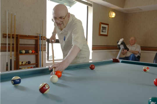 Senior Living Residents playing pool at Daystar Retirement Village in West Seattle