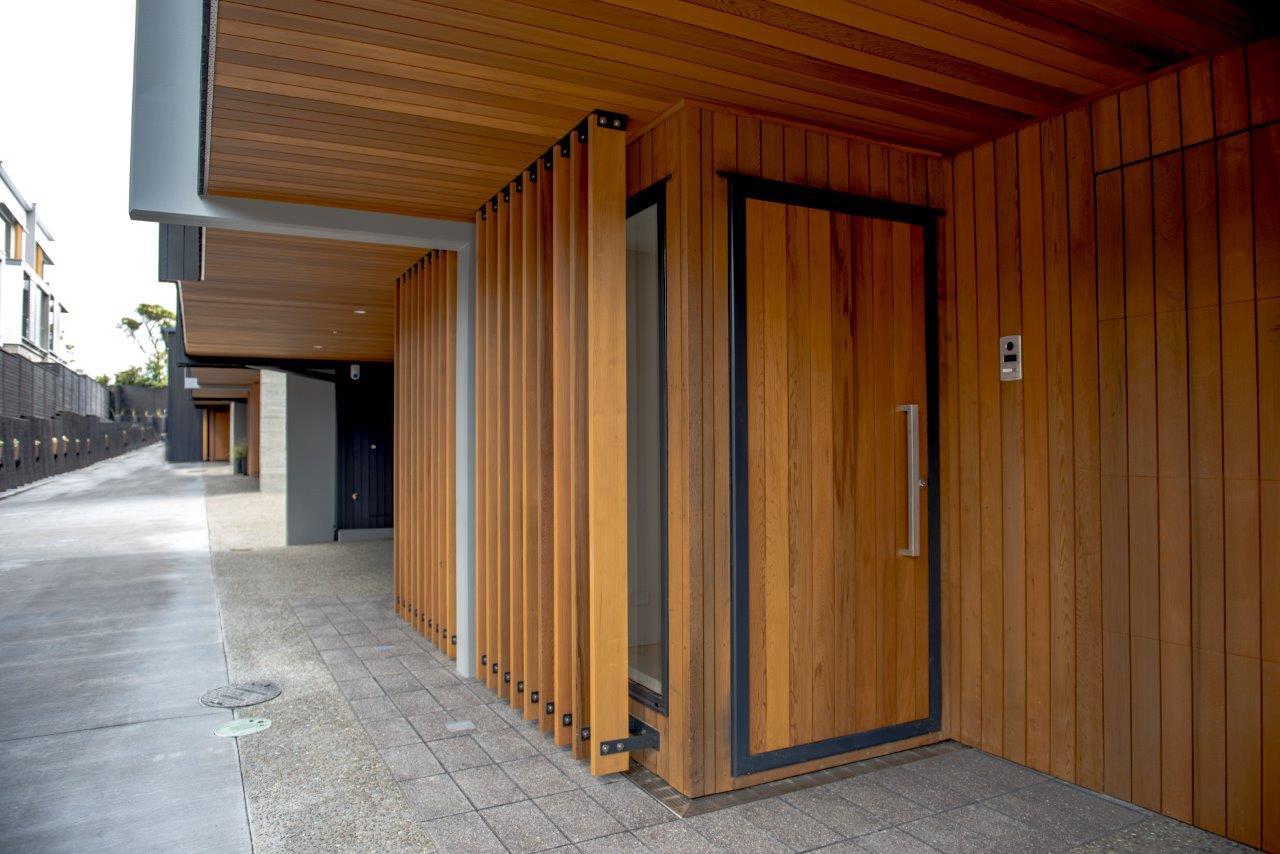 doors are us - Cedar door beside Cedar decorative fins