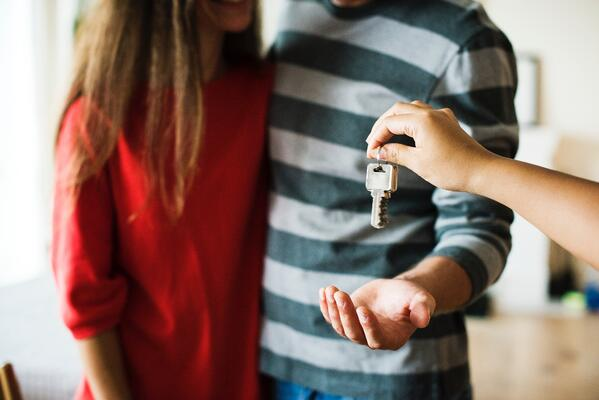 couple being handed keys to new house