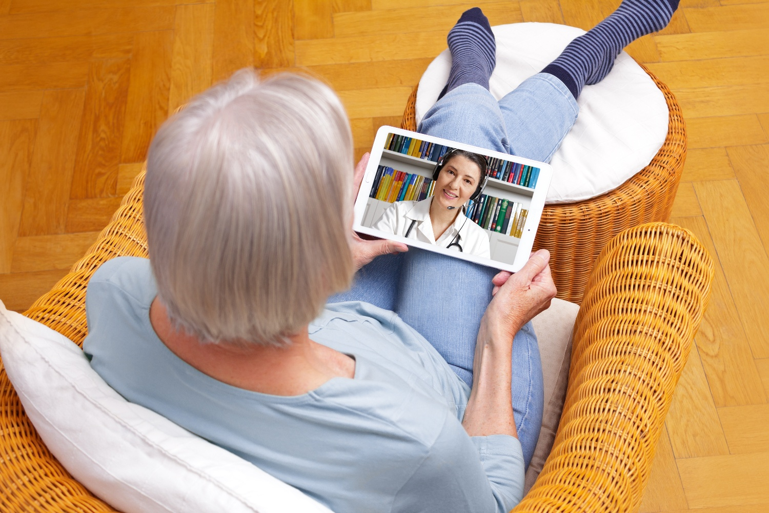 senior woman using telehealth technology