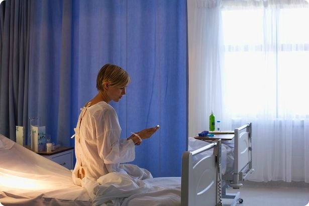 Patient-using-cell-phone-in-hospital-bed.jpg