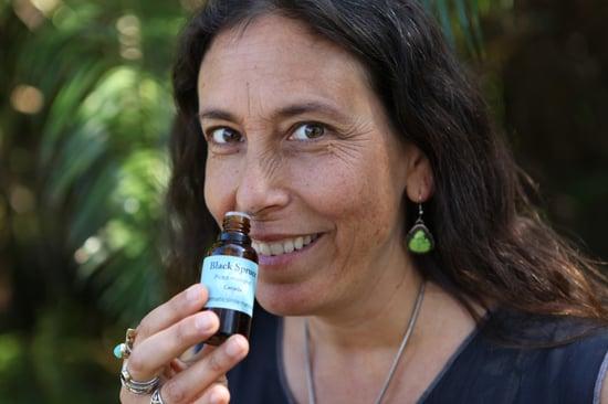 Andrea smelling Black Spruce!