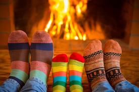 bigstock-Family-Near-Fireplace-204672886