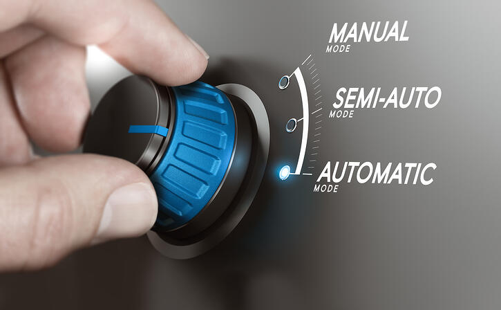 dial showing manual, semi-auto, and automatic