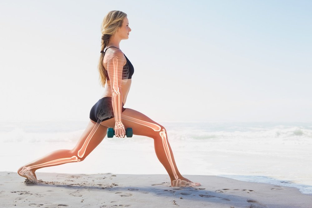 Digital composite of Highlighted bones of exercising woman.jpeg