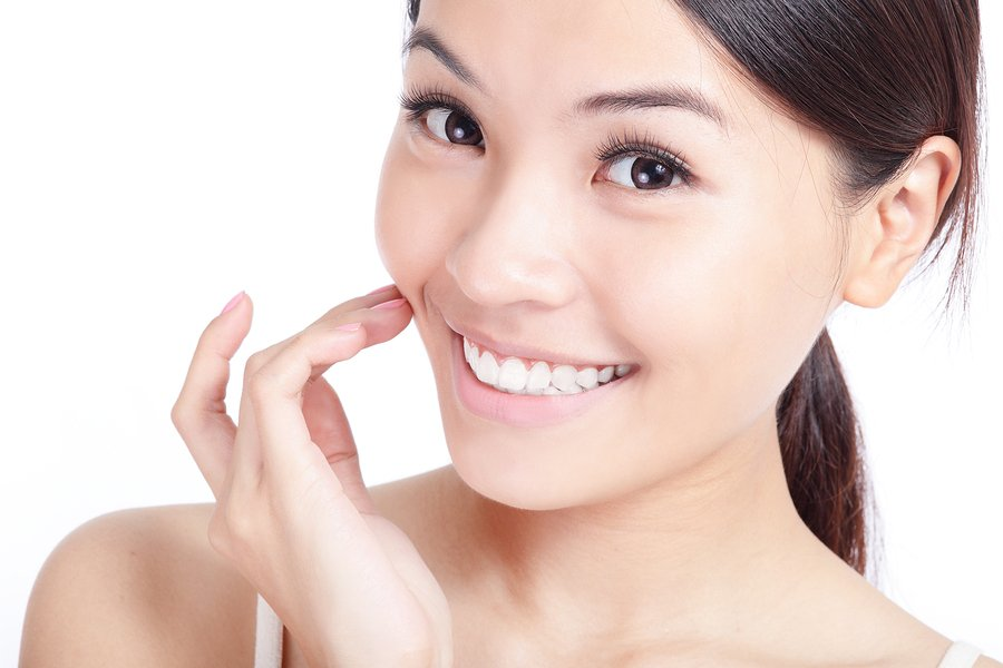 bigstock-Young-Smiling-Woman-Hand-Touch-51034009.jpg