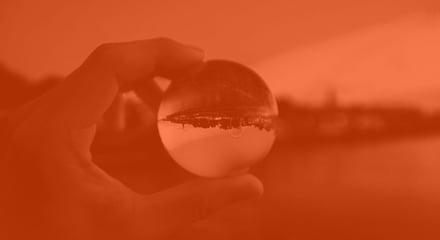 Hand holding crystal sphere_darkOrange