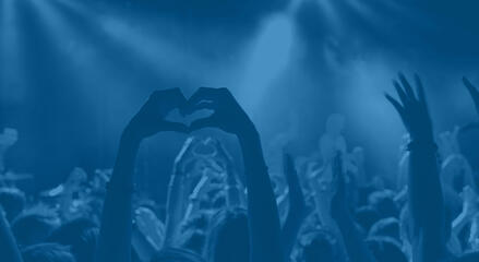 Hands heart in crowd_blue