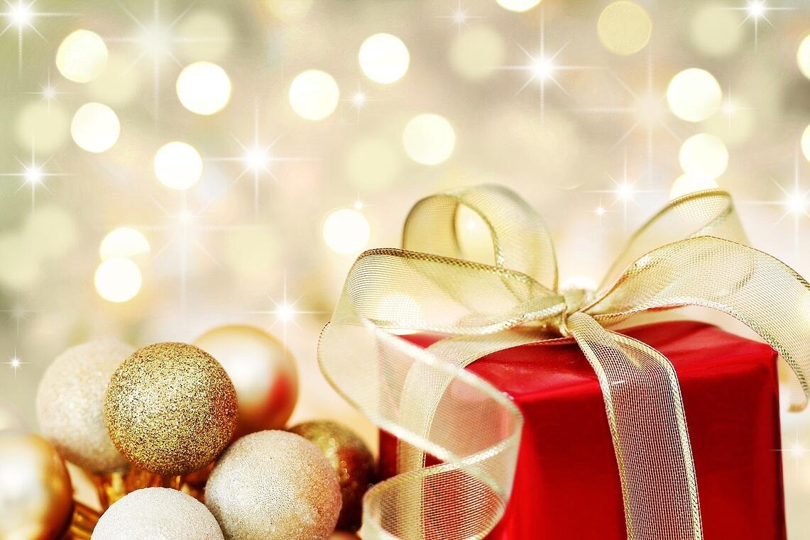 bigstock-Christmas-Gift-On-Defocused-Li-6064726-2