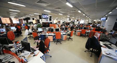 reporters-at-desks-in-newsroom