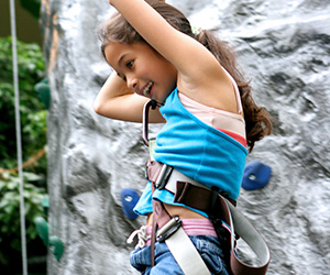 kid at sacramento gym with indoor climbing wall
