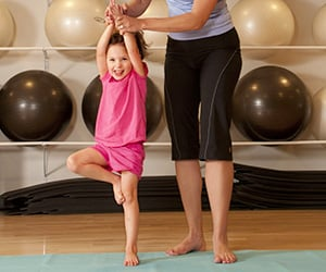 child and parent doing yoga for kids
