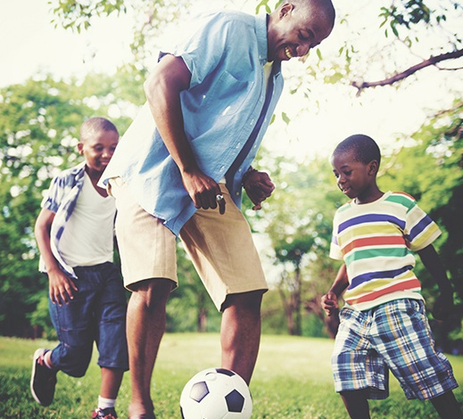 CFF Family Playing Soccer