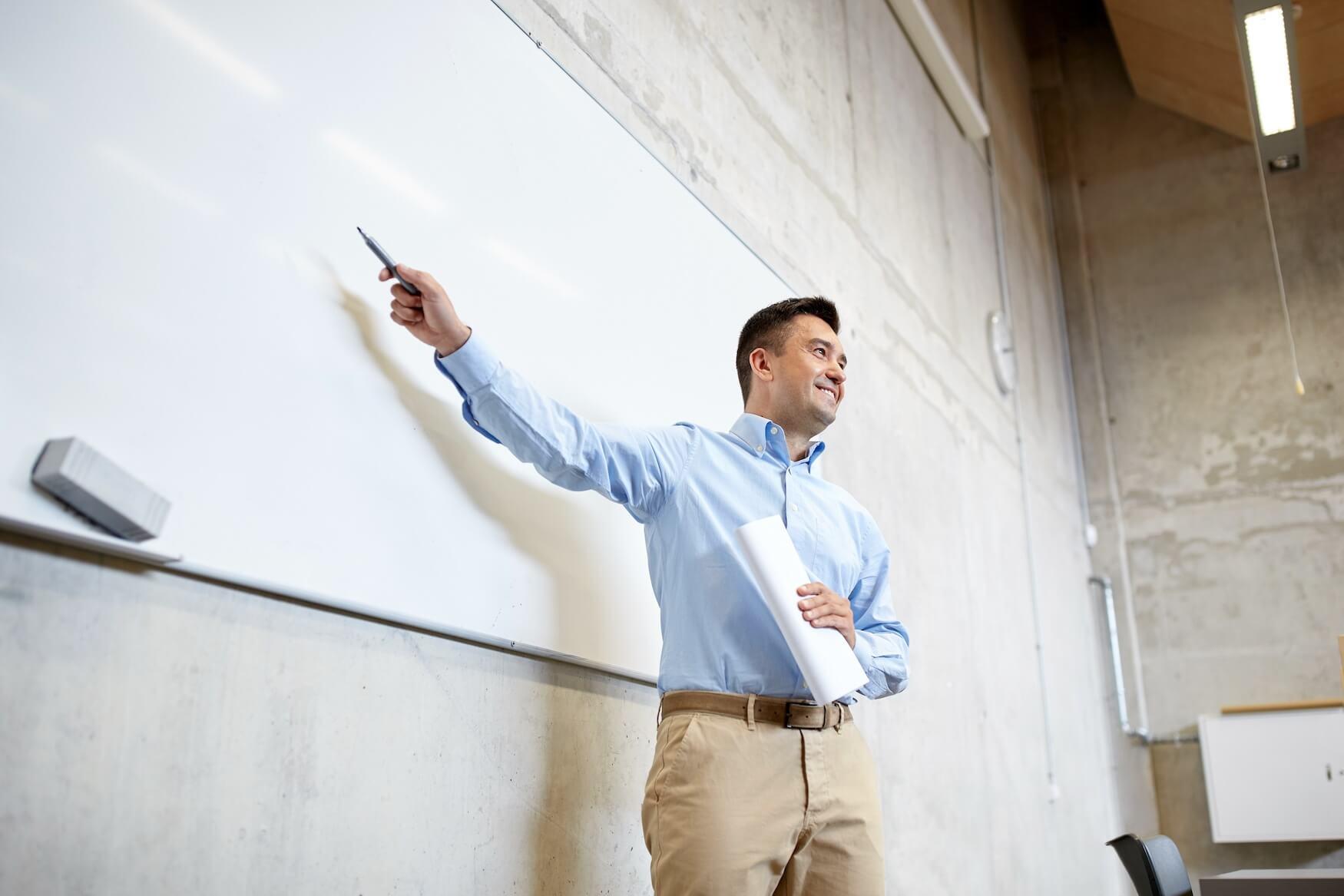 white board man pointing rx.jpeg