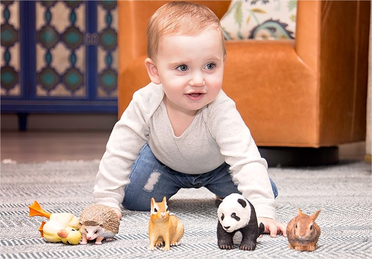 Baby crawling towards some toys