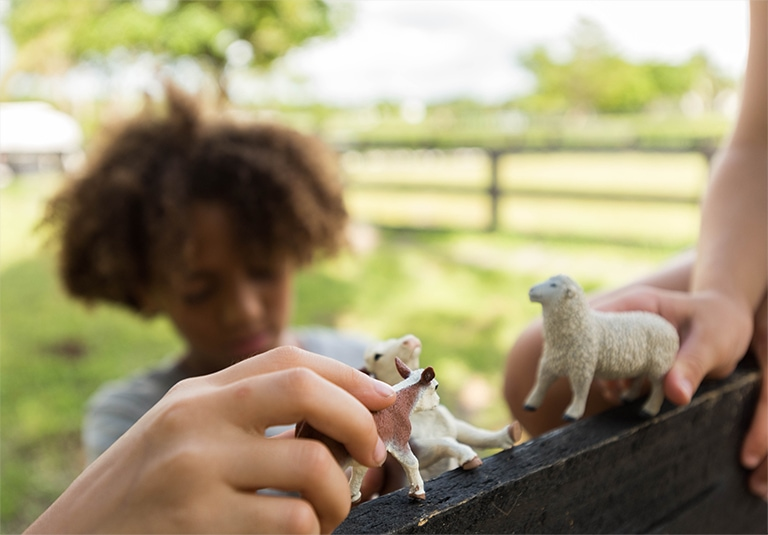 Kids playing with farm toys