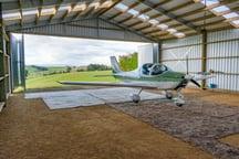 Airplane hangar with bifold doors