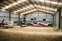 Aircraft hangar with clearlight and bird=proof rafters