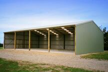 Timber poles paired with coloursteel make for a beautiful shed